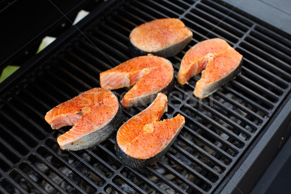 Stock photo: Salmon fish roasted on barbecue grill.
