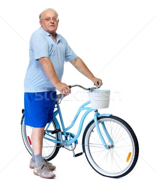 Elderly man with bicycle. Stock photo © Kurhan