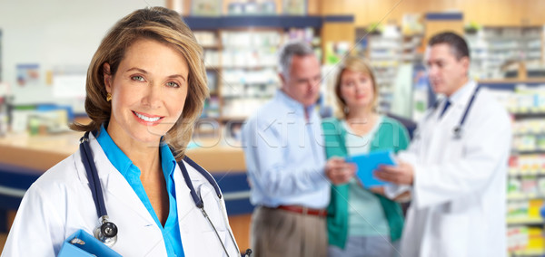 Elderly pharmacist doctor woman. Stock photo © Kurhan