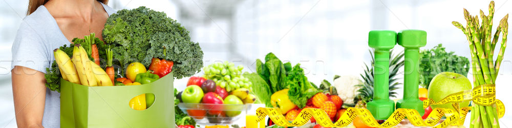 Stock photo: Woman hands with Vegetables and fruits.