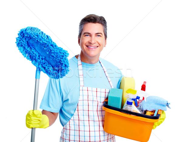 Huishoudelijk werk knap glimlachend man geïsoleerd witte Stockfoto © Kurhan
