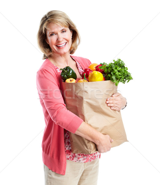 Senior woman with a grocery shopping bag. Stock photo © Kurhan