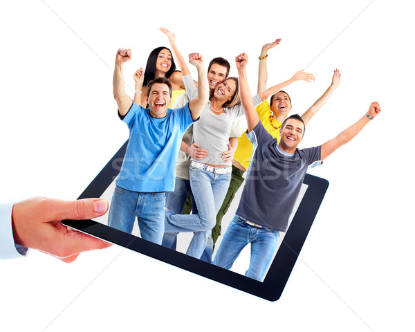 Stock photo: Tablet computer and group of happy people.