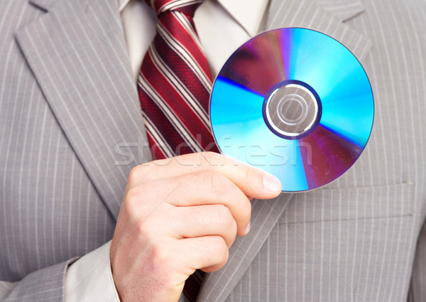 Businessman with a CD. Stock photo © Kurhan
