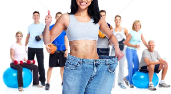 Slimming woman wearing big pants. Stock photo © Kurhan