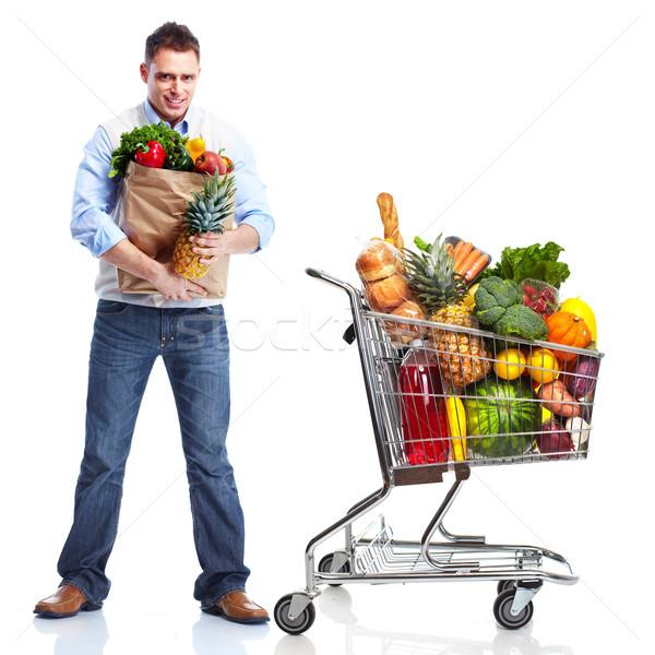 Happy man with a shopping cart. Stock photo © Kurhan