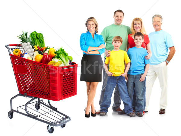 Happy family with a grocery shopping cart. Stock photo © Kurhan