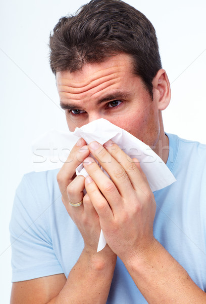 Sneezing man having cold. Stock photo © Kurhan