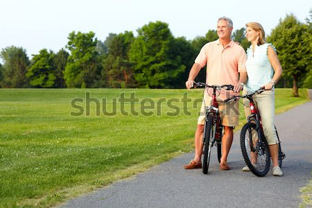 Happy senior couple cyclist. Stock photo © Kurhan