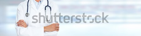 Female doctor over medical background. Stock photo © Kurhan