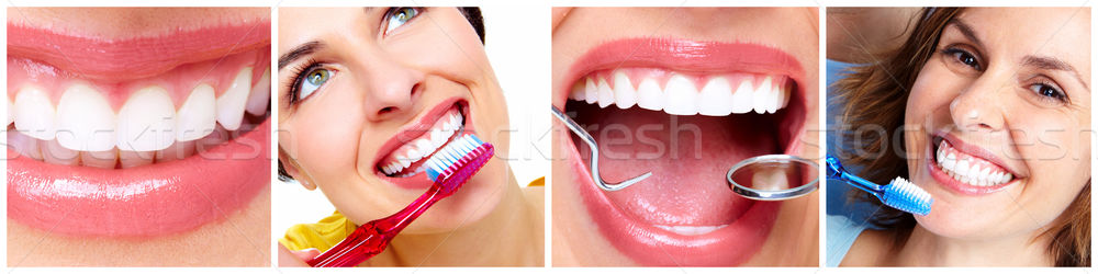 Teeth with toothbrush. Stock photo © Kurhan