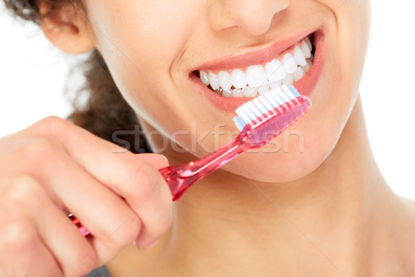 Woman with toothbrush. Stock photo © Kurhan