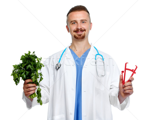 Doctor with body fat calipers and parsley. Stock photo © Kurhan