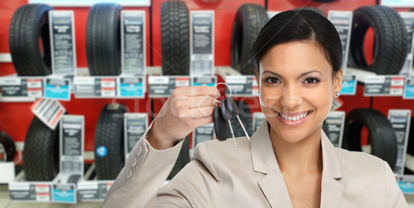 Auto dealer woman with a car key. Stock photo © Kurhan