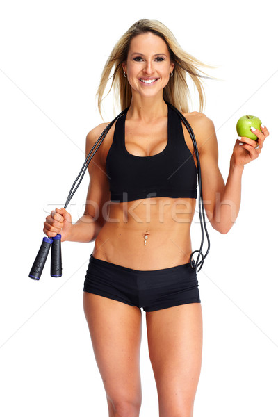 Young fitness woman with apple. Stock photo © Kurhan