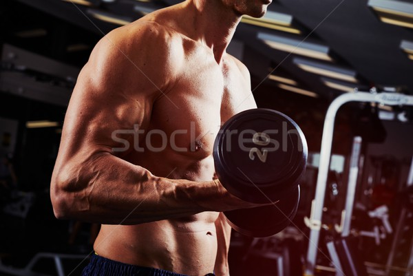 Dumbbell biceps workout Stock photo © Kurhan