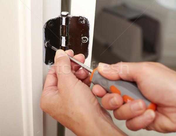 двери зависеть установка рук отвертка Сток-фото © Kurhan