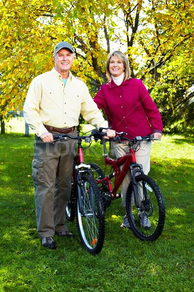 Senior couple cycling Stock photo © Kurhan