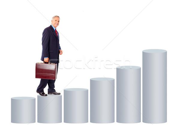 Zakenman glimlachend volwassen grafiek geïsoleerd witte Stockfoto © Kurhan
