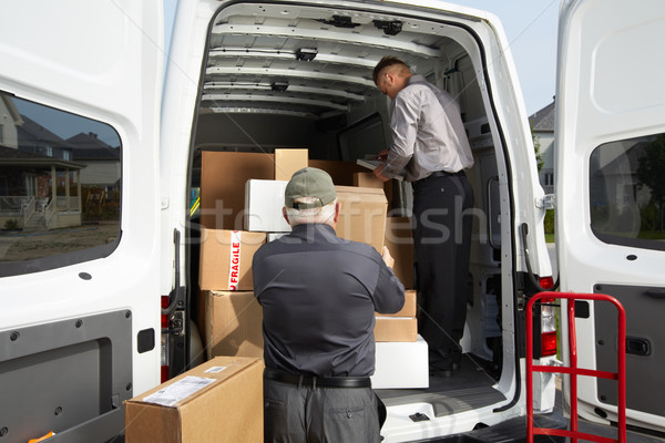 Delivery men with parcels. Stock photo © Kurhan
