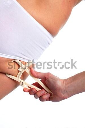 Woman measuring body fat. Stock photo © Kurhan
