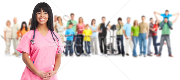 Smiling nurse and people group. Stock photo © Kurhan