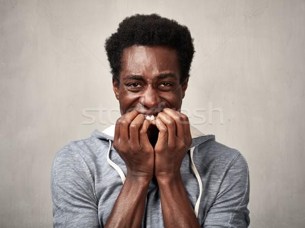 Scared black man face. Stock photo © Kurhan