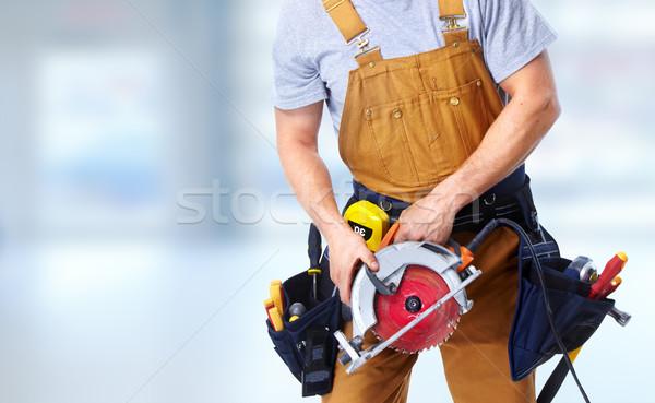 Bouwvakker elektrische zag handen tool gordel Stockfoto © Kurhan