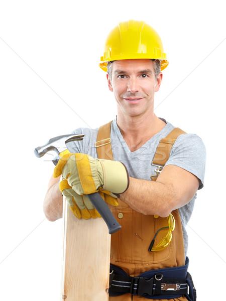 Auftragnehmer jungen gut aussehend gelb einheitliche isoliert Stock foto © Kurhan