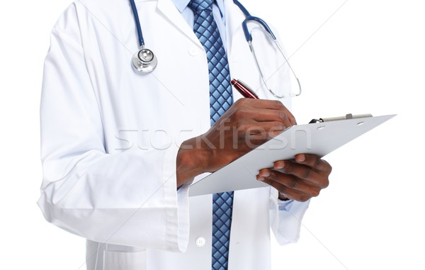 Hands of medical doctor with a clipboard Stock photo © Kurhan