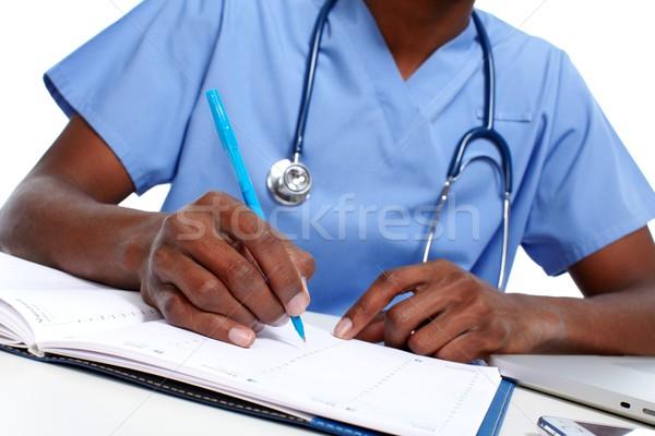 Mãos médico médico escrita prescrição escritório Foto stock © Kurhan
