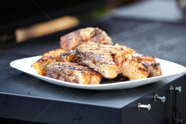 Salmon fish roasted on barbecue grill. Stock photo © Kurhan