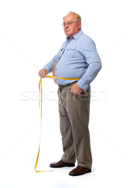 Old man measuring waist with a tape.  Stock photo © Kurhan