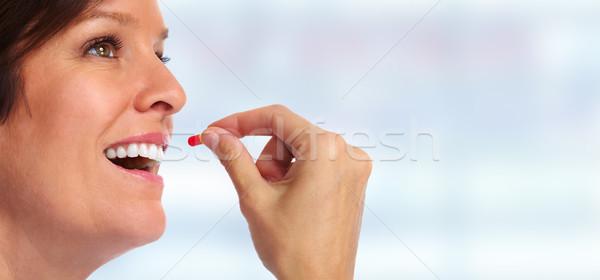 Woman with pill. Stock photo © Kurhan