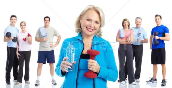 Tornaterem fitnessz egészséges életmód mosolyog emberek fehér Stock fotó © Kurhan