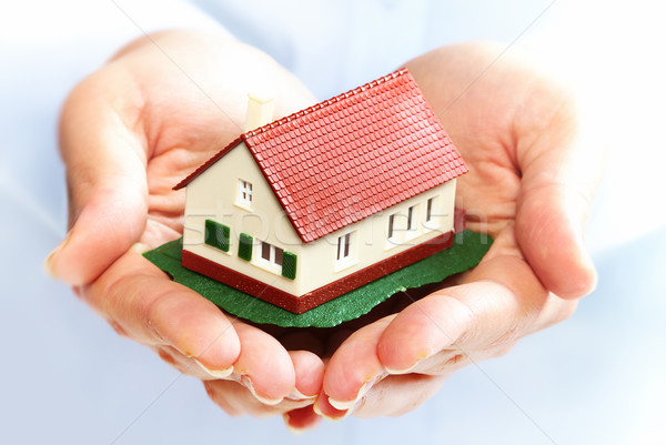 Hands with little house. Stock photo © Kurhan