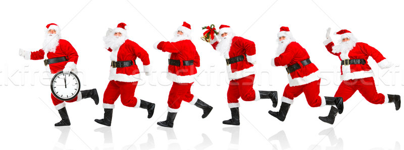 Happy running Christmas Santas Stock photo © Kurhan