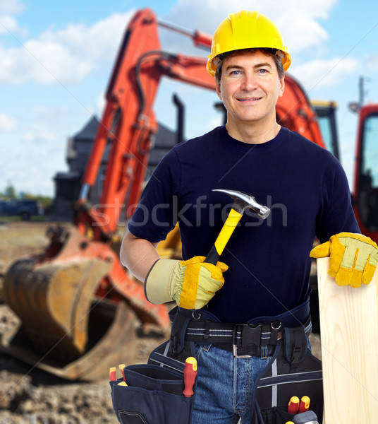 Construction worker near excavator. Stock photo © Kurhan