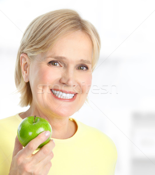 Woman with apple Stock photo © Kurhan