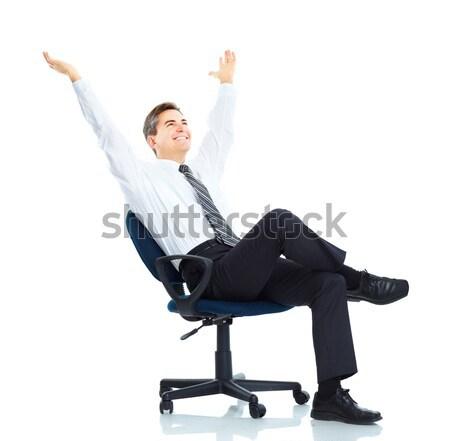 üzletember mosolyog jóképű dolgozik laptop izolált Stock fotó © Kurhan