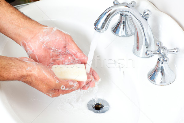 Man washing hands with soap and water. Stock photo © Kurhan