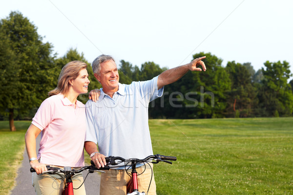 Senior couple cycling. Stock photo © Kurhan