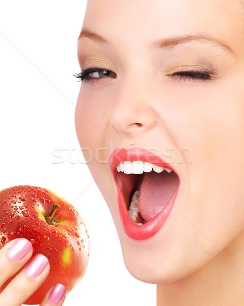Stock photo: Woman eating apple.