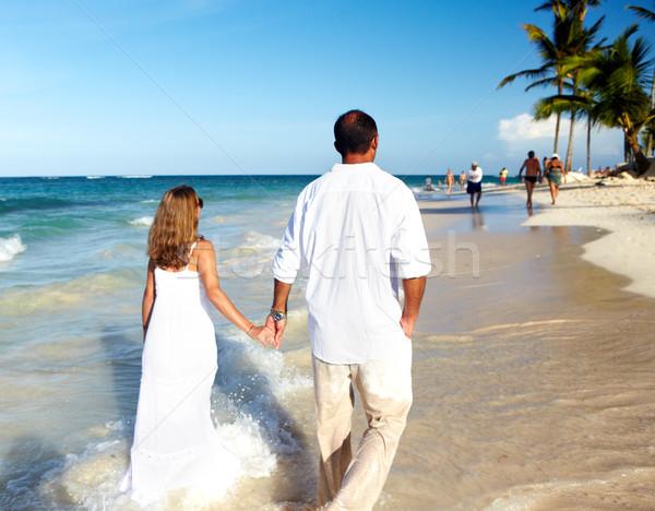 Loving couple walking on sandy beach.  Stock photo © Kurhan