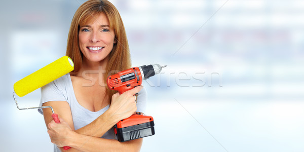 Beautiful woman with drill and paint roller. Stock photo © Kurhan