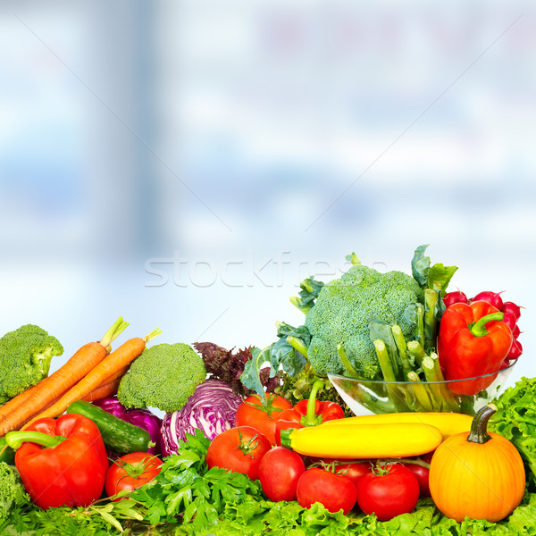 Vegetables and fruits over green background. Stock photo © Kurhan