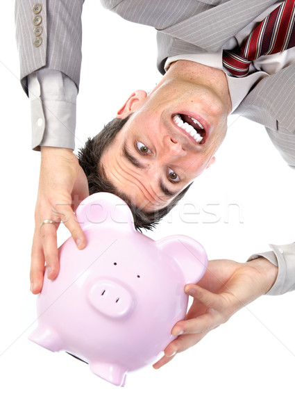 Businessman with a piggy bank Stock photo © Kurhan