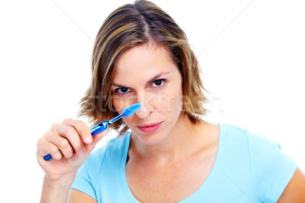 Woman with toothbrush. Stock photo © Kurhan