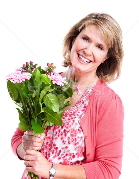 Happy senior woman with flowers. Stock photo © Kurhan