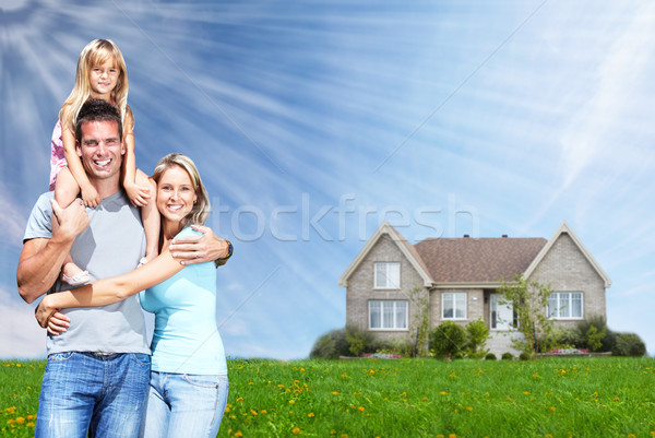 Happy family near new home. Stock photo © Kurhan